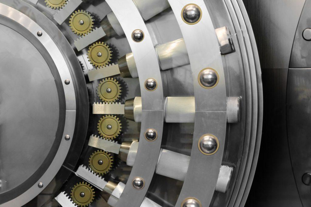 stock-photo-an-open-safe-door-in-a-vault-132997859